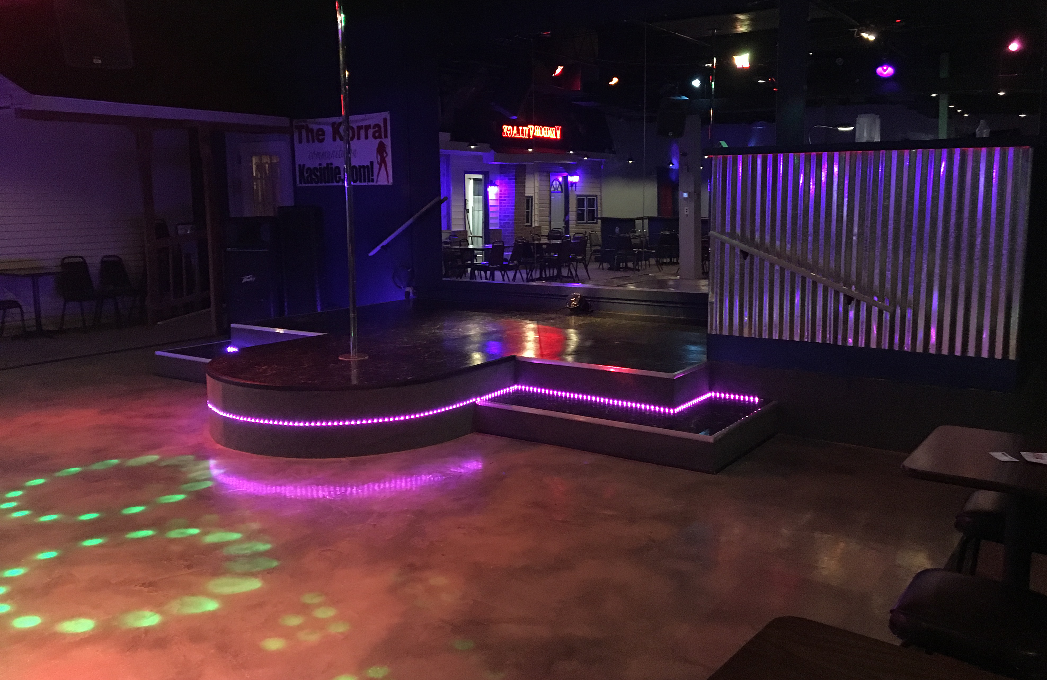 The Korral's dance floor with stage, stripper pole and DJ booth